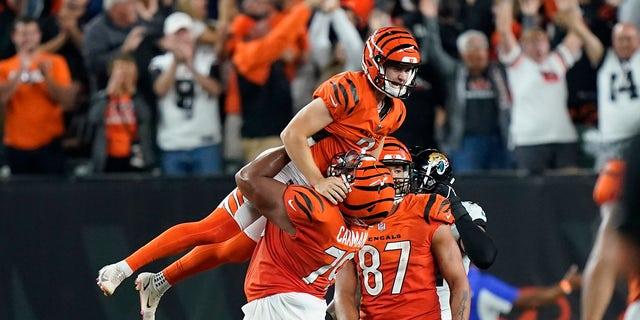 The Cincinnati Bengals celebrate with kicker Evan McPherson (2) and Jackson Carmen () in an NFL football game against the Jacksonville Jaguars on Thursday, Sept. 2021, in Cincinnati.  Cincinnati won 24-21.