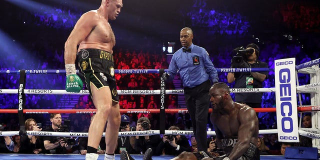 Tyson Fury knocks down Deontay Wilder in the fifth round during their Heavyweight bout for Wilder's WBC and Fury's lineal heavyweight title on Feb. 22, 2020 at MGM Grand Garden Arena in Las Vegas.