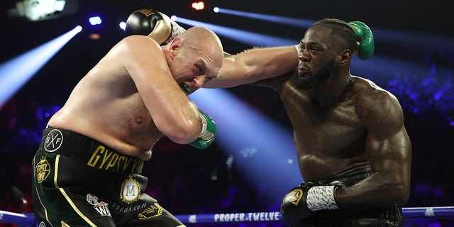 Deontay Wilder punches Tyson Fury during their Heavyweight bout for Wilder's WBC and Fury's lineal heavyweight title on Feb. 22, 2020 at MGM Grand Garden Arena in Las Vegas.