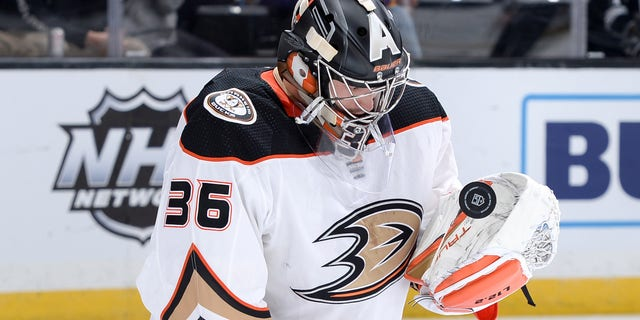 LOS ANGELES, CA - OCTOBER 9: John Gibson #36 of the Anaheim Ducks protects the goal during the first period against the Los Angeles Kings at STAPLES Center on October 9, 2021 in Los Angeles, California. (Photo by Andrew D. Bernstein/NHLI via Getty Images