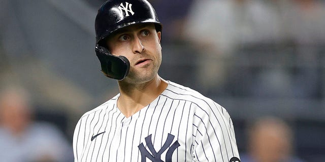 Joey Gallo #13 of the New York Yankees reacts after striking out during the third inning against the Texas Rangers at Yankee Stadium on September 21, 2021 in the Bronx borough of New York City.
