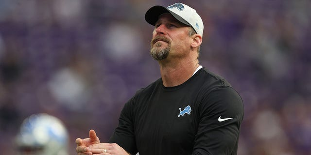 Head coach Dan Campbell of the Detroit Lions looks on before the game against the Green Bay Packers at U.S. Bank Stadium October 10, 2021 in Minneapolis, Minn.