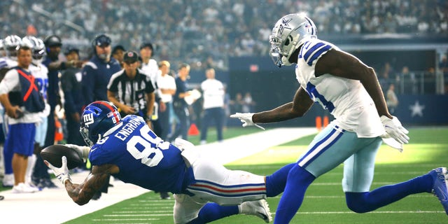 Evan Engram (88) of the New York Giants catches the ball during the third quarter against the Dallas Cowboys at AT&T Stadium on Oct. 10, 2021, in Arlington, Texas.