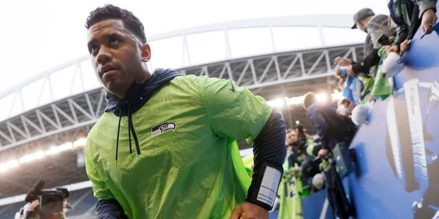 SEATTLE, WASHINGTON - OCTOBER 25: Russell Wilson #3 of the Seattle Seahawks participates in warmups prior to a game against the New Orleans Saints at Lumen Field on October 25, 2021 in Seattle, Washington. (Photo by Steph Chambers/Getty Images)