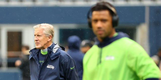 SEATTLE, WASHINGTON - OCTOBER 25: Head Coach Pete Carroll of the Seattle Seahawks looks on alongside Russell Wilson #3 before the game against the New Orleans Saints at Lumen Field on October 25, 2021 in Seattle, Washington. (Photo by Abbie Parr/Getty Images)