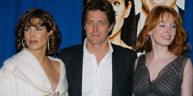 Sandra Bullock, Hugh Grant and Alicia Witt (l. to r.) arrive at the Ziegfeld Theater for the New York premiere of the movie 'Two Weeks Notice.' They star in the film and Bullock doubled as producer.