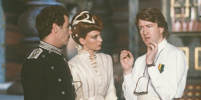 American actor Dean Stockwell (left), British actress Francesca Annis and David Lynch on the set of 'Dune.'