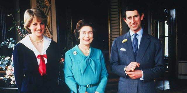Lady Diana Spencer and Prince Charles pose with Queen Elizabeth at Buckingham Palace, London, in March 1981, the day that their wedding was sanctioned by the Privy Council.