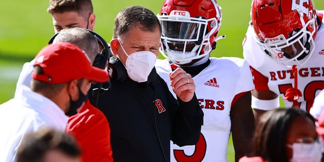 Head coach Greg Schiano of the Rutgers Scarlet Knights talks to his team during a game against the Michigan State Spartans at Spartan Stadium on Oct. 24, 2020 in East Lansing, Michigan.