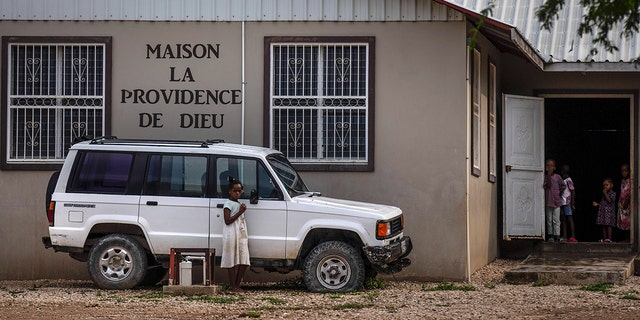 Children stand in the courtyard of the Maison La Providence de Dieu orphanage it Ganthier, Croix-des-Bouquets, Haiti, on Sunday where a gang abducted 17 missionaries from a U.S.-based organization.