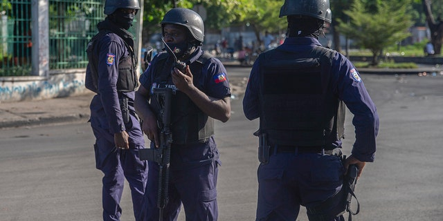 Armed forces secure the area where the Haiti's Prime Minister Ariel Henry placed a bouquet of flowers in front of independence hero Jean Jacques Dessalines memorial in Port-au-Prince, Haiti, on Sunday.