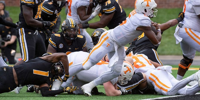 Tennessee quarterback Hendon Hooker, right, scores a touchdown during the second quarter of an NCAA college football game against Missouri Saturday, Oct. 2, 2021, in Columbia, Mo.