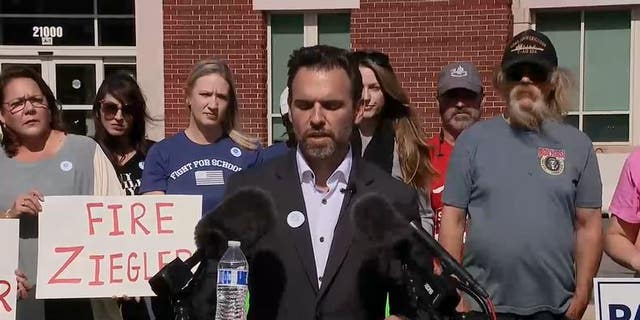 Ian Prior speaks outside of the Loudoun County Public School Administration building in Ashburn, Virginia.
