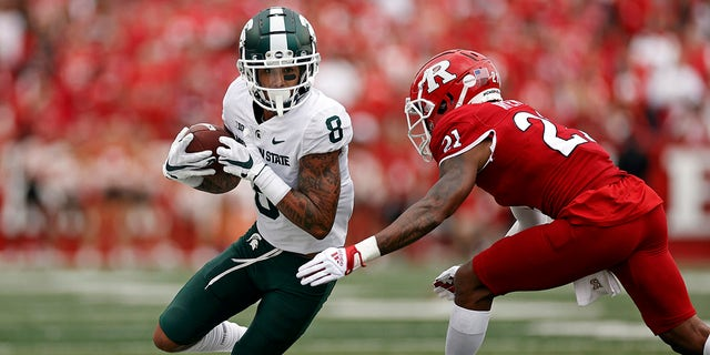Michigan State wide receiver Jalen Nailor (8) is forced out of bounds by Rutgers defensive back Tre Avery during the first half of an NCAA college football game Saturday, Oct. 9, 2021, in Piscataway, N.J.