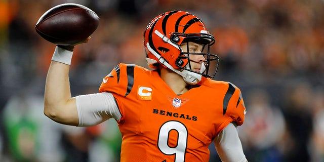 Sep 30, 2021; Cincinnati, Ohio, USA; Cincinnati Bengals quarterback Joe Burrow (9) throws during the first quarter against the Jacksonville Jaguars at Paul Brown Stadium.
