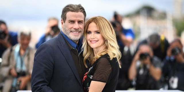 John Travolta and his wife Kelly Preston pose on May 15, 2018 during a photocall for the film 'Gotti' at the 71st edition of the Cannes Film Festival in Cannes, southern France.