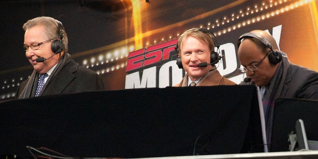 Members of the Monday Night announcing crew Ron Jaworski, John Gruden and Mike Tirico of ESPN look on during the game between the New England Patriots and the New York Jets at Gillette Stadium on December 06, 2010 in Foxboro, Massachusetts.