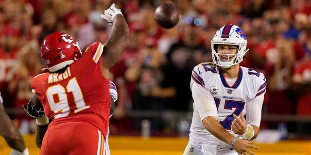 Buffalo Bills quarterback Josh Allen (17) throws over Kansas City Chiefs defensive tackle Derrick Nnadi (91) during the first half of an NFL football game Sunday, Oct. 10, 2021, in Kansas City, Mo.