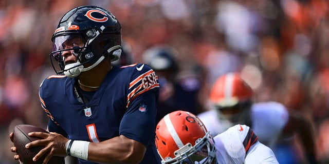Cleveland Browns defensive end Myles Garrett, right, sacks Chicago Bears quarterback Justin Fields during the second half of an NFL football game, Sunday, Sept. 26, 2021, in Cleveland.