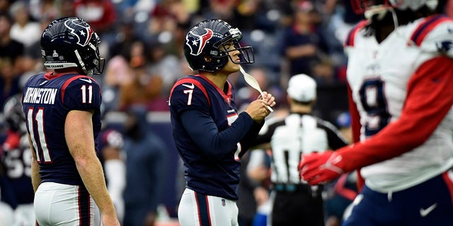 Houston Texans place kicker Ka'imi Fairbairn (7) reacts after missing an extra point against the New England Patriots during the first half of an NFL football game Sunday, Oct. 10, 2021, in Houston.
