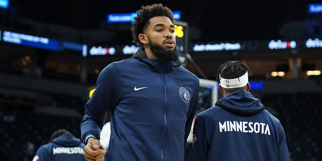 Karl-Anthony Towns of the Minnesota Timberwolves looks on before a preseason game against the New Orleans Pelicans Oct. 4, 2021 at Target Center in Minneapolis, Minn.