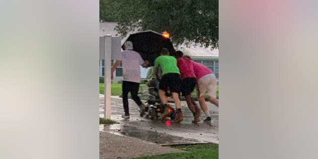 Katty Castro, a public relations representative at the Florida Living Independent Community inSeminole County, Florida, witnessed the rescue and snapped pictures of the group who valiantly pushed the resident's scooter to her planned destination.