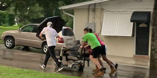 Four young men stepped up to help a woman after her scooter broke down in the middle of a street in Seminole County, Florida.