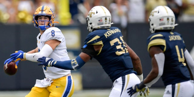 Pittsburgh quarterback Kenny Pickett (8) works against Georgia Tech during the first half of an NCAA college football game, Saturday, Oct. 2, 2021, in Atlanta.