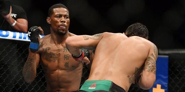 Kevin Holland (blue gloves) fights Anthony Hernandez (red gloves) during UFC on ESPN at VyStar Veterans Memorial Arena.