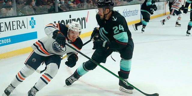 Edmonton Oilers' James Hamblin (57) skates past Seattle Kraken's Jamie Oleksiak (2) in the first period of a preseason NHL hockey game Friday, Oct. 1, 2021, in Everett, Wash.