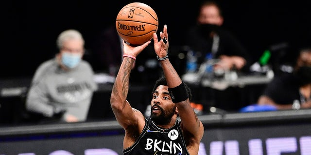 Kyrie Irving of the Brooklyn Nets attempts a jump shot against the Milwaukee Bucks in Game 2 of the second round of the 2021 NBA Playoffs at Barclays Center on June 7, 2021 in New York City.