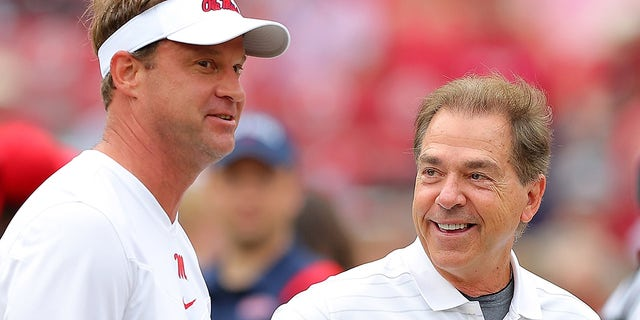 Head coach Nick Saban of the Alabama Crimson Tide, right, talks with head coach Lane Kiffin of the Mississippi Rebels before a game at Bryant-Denny Stadium Oct. 2, 2021 in Tuscaloosa, Alabama.