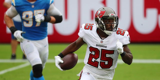 Oct 4, 2020; Tampa, Florida, USA; Tampa Bay Buccaneers running back LeSean McCoy (25) runs the ball against the Los Angeles Chargers in the first quarter of a NFL game at Raymond James Stadium.