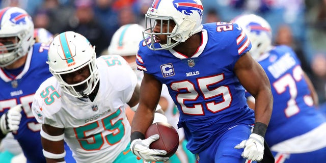 Dec 30, 2018; Orchard Park, NY, USA; Buffalo Bills running back LeSean McCoy (25) runs with the ball past Miami Dolphins outside linebacker Jerome Baker (55) during the first quarter at New Era Field.