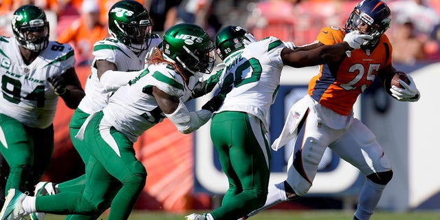 Denver Broncos running back Melvin Gordon (25) eludes the tackle of New York Jets free safety Marcus Maye (20) during the second half of an NFL football game, Sunday, Sept. 26, 2021, in Denver.