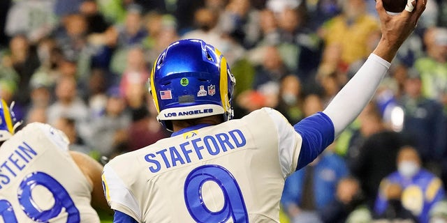 Los Angeles Rams quarterback Matthew Stafford (9) passes with tape on one of his fingers during the second half of an NFL football game against the Seattle Seahawks, Thursday, Oct. 7, 2021, in Seattle.