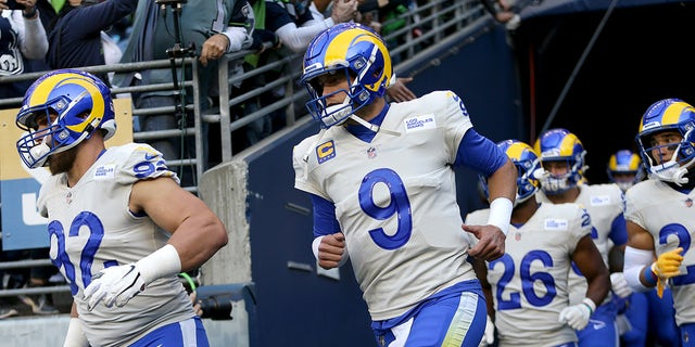 Quarterback Matthew Stafford #9 of the Los Angeles Rams takes the field before the start of the Rams and Seattle Seahawks game at Lumen Field on Oct. 7, 2021 in Seattle, Washington.