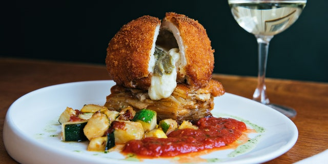 Cru Cafe's Mozzarella and Poblano Fried Chicken is loosely based off Chicken Cordon Bleu, but with a Southern twist, Executive Chef John Zucker tells Fox News.