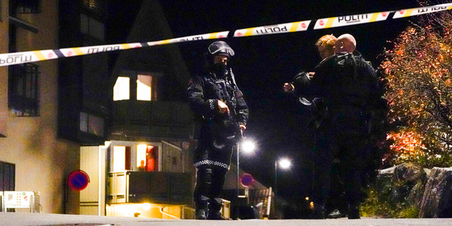 Police at the scene after an attack in Kongsberg, Norway, Wednesday, Oct. 13, 2021.