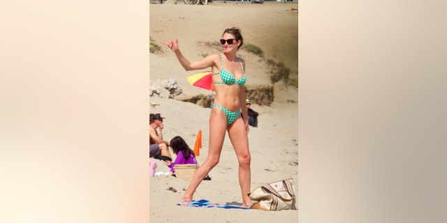 Shailene Woodley was seen chatting with surfers during a beach outing in Malibu on Wednesday afternoon.