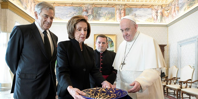 U.S. Speaker of the House Nancy Pelosi and her husband Paul Pelosi meet with Pope Francis at the Vatican Oct. 9, 2021.