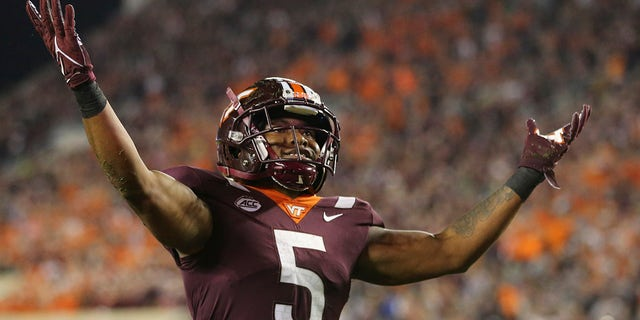 Virginia Tech running back Raheem Blackshear (5) celebrates after scoring a touchdown against Notre Dame during the first half of an NCAA college football game in Blacksburg, Va., Saturday, Oct. 9, 2021.