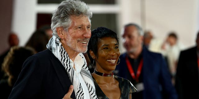Roger Waters and a guest walk the red carpet ahead of the 'Roger Waters Us + Them' screening during the 76th Venice Film Festival at Sala Darsena on September 06, 2019 in Venice, Italy.