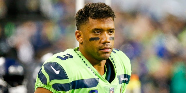 Seattle Seahawks quarterback Russell Wilson stands on the sideline during the fourth quarter against the Los Angeles Rams at Lumen Field.