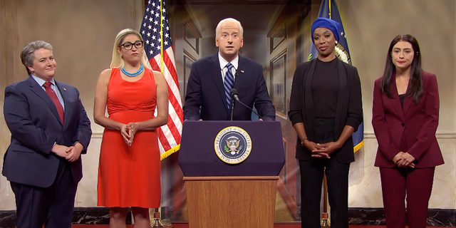 """President Joe Biden (center played by James Austin Johnson) during the cold open on """"SNL."""""""