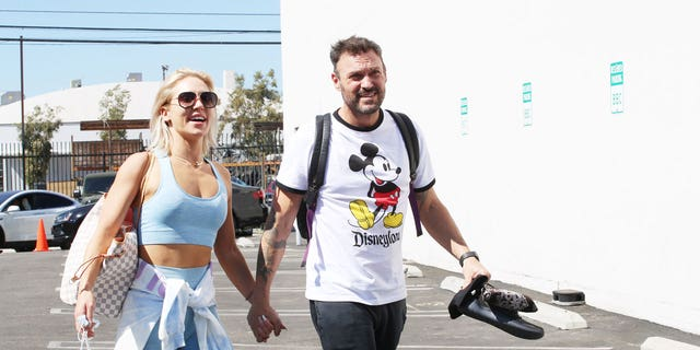 Brian Austin Green and Sharna Burgess are seen arriving at the 'Dancing with the Stars' rehearsal studio on October 1, 2021 in Los Angeles, California.