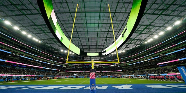 The field at SoFi Stadium sits empty during a weather delay shortly before the scheduled start of an NFL football game between the Los Angeles Chargers and the Las Vegas Raiders, Monday, Oct. 4, 2021, in Inglewood, Calif.