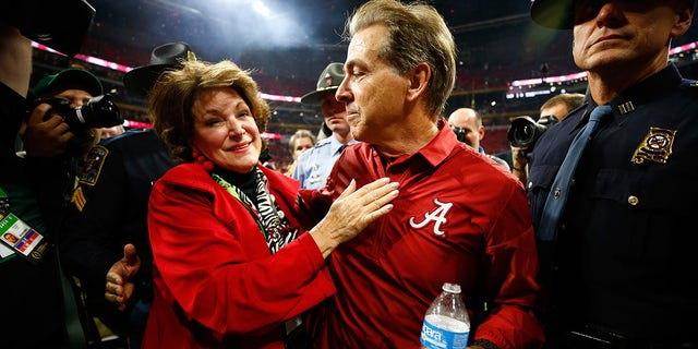 Head coach Nick Saban of the Alabama Crimson Tide celebrates with his wife Terry after beating the Georgia Bulldogs in overtime to win the CFP National Championship presented by AT&T at Mercedes-Benz Stadium on Jan. 8, 2018 in Atlanta, Georgia. Alabama won 26-23.