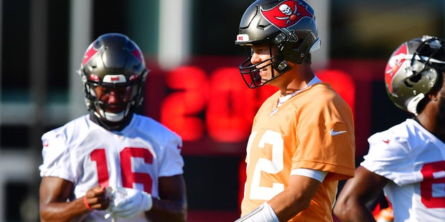 Tom Brady #12 of the Tampa Bay Buccaneers looks on during training camp at AdventHealth Training Center on July 26, 2021 in Tampa, Florida.