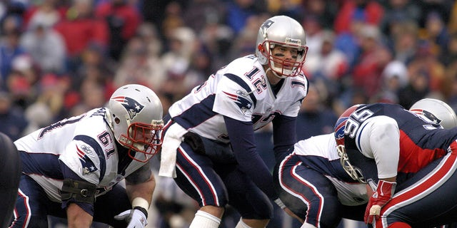 New England Patriots quarterback Tom Brady calls out signals at the line during a game against the Buffalo Bills at Ralph Wilson Stadium in Orchard Park, New York on December 11, 2005. New England won the game 35-7.